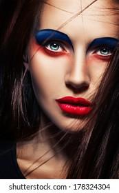 closeup beauty creative red and blue makeup woman face