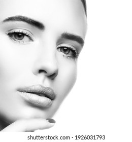 Close-up beauty face of attrctive cute sensual young model woman, healthy perfect skin, makeup. Black and white. Skincare facial treatment concept