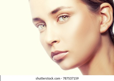 Close-up beauty face of caucasian young model girl with nude make-up, natural lips, clean skin. Skincare treatment woman health concept