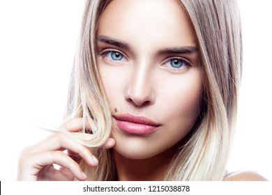 Close-up beauty face of young model girl with healthy clean fresh skin, natural make-up, blond hair, blue eyes. Attractive pretty woman. Skincare facial treatment concept