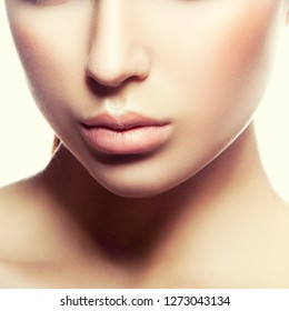 Close-up beauty girl lips, part of face, clean skin. Natural nude make-up, clean skin. Skincare facial treatment concept