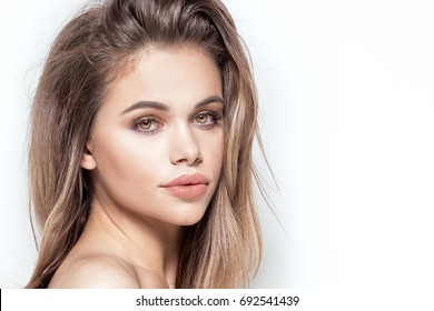 Closeup beauty portrait of attractive natural brunette woman with glamour makeup.