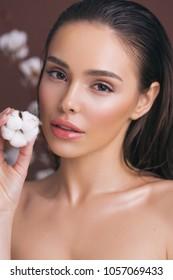 Closeup beauty portrait with cotton buds