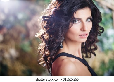 Close-up beauty portrait of gorgeous brunette woman with perfect makeup and hairstyle