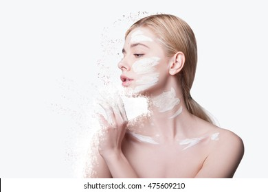 Close-up Beauty Portrait model  Woman Applies a Mask to the Face. Isolated on white background.  Skincare, skin health and nutrition. Girl in profile, with a white mask on her face