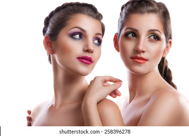 Close-up beauty portrait of two beautiful young women . two female twins