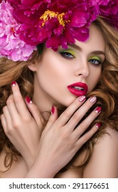 Close-up beauty portrait of young pretty girl with flower wreath in her hair wearing bright pink lipstick, touching her lips. Bright modern summer makeup. Beauty, spa, manicure  and skincare concept