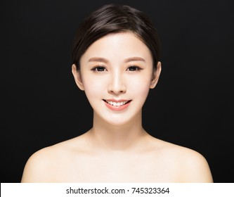 closeup Beauty woman face isolated on black background