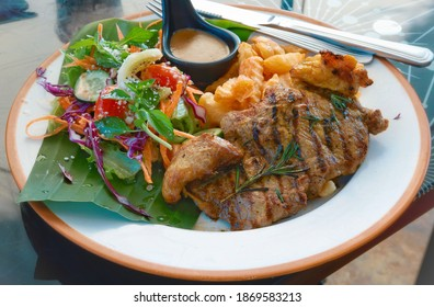 Closeup beef steak with salad and frenchfries