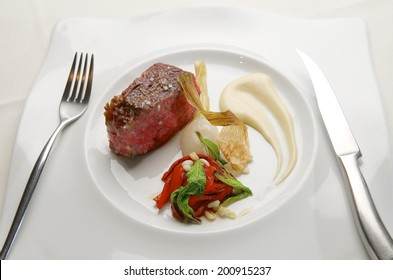 closeup of a beef steak with vegetable garnish
