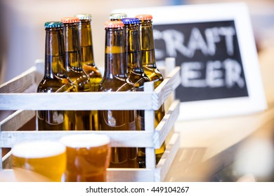 Close-up of beer bottles in crate at bewery