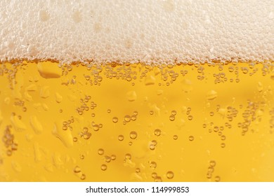 Close-up of a beer glass with condensation and froth