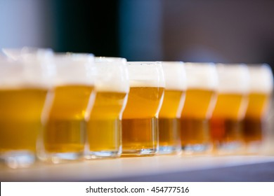 Close-up of beer glasses on the counter in restaurant
