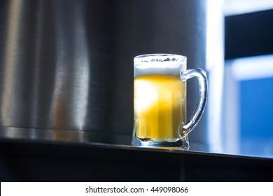 Close-up of beer pint at bewery