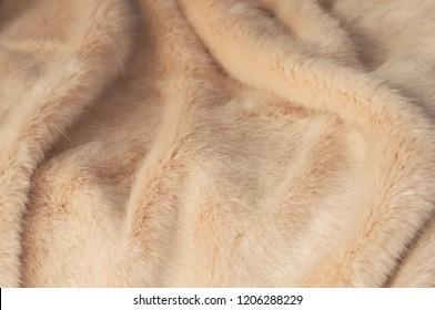 closeup of beige blanket texture