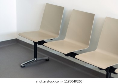 Closeup of beige chair alignment in a waiting room