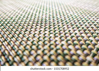 close-up of beige fabric plastic lattice, grid texture pattern