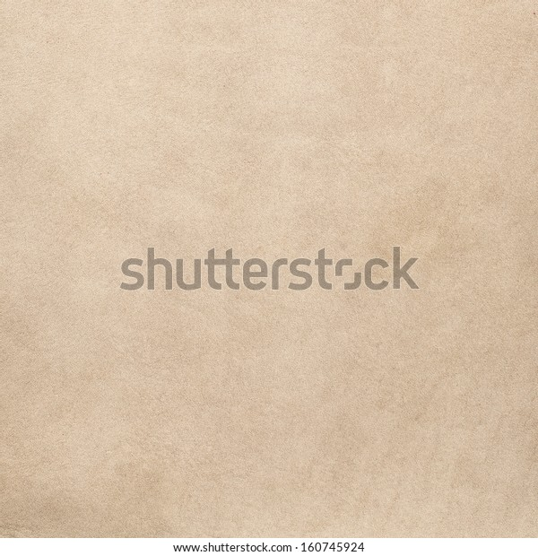 Closeup of beige leather texture background.