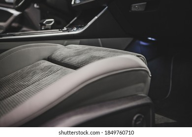 close-up beige seat of business car with gear shifter on background