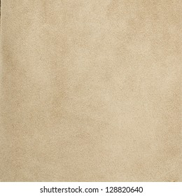 Closeup of beije leather texture background.