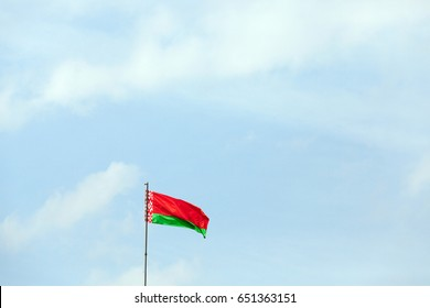 close-up of a Belarusian flag photographed against a blue sky