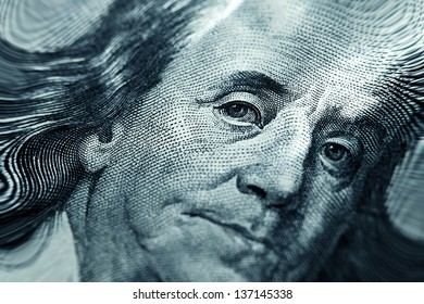 Close-up of Benjamin Franklin on the $100 bill. Pincushion lens