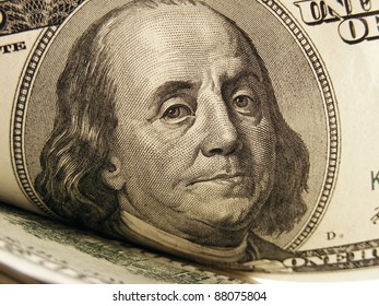 Close-up of Benjamin Franklin on the $100 bill. Finance concept.