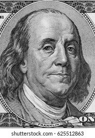 Closeup of Benjamin Franklin on hundred dollar American banknote