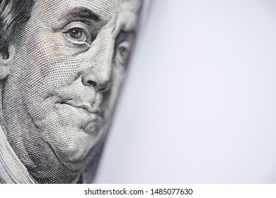 Closeup of Benjamin Franklin from US dollar banknote. USD is the main of currency exchange in the world.