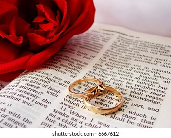 Closeup of Bible & wedding rings