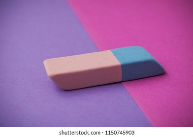 closeup of bicolor eraser on pink and purple background