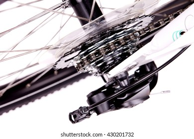 Closeup of bicycle chain, brakes and rear derailleur