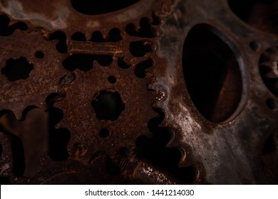 Close-up of bicycle chainring with natural rust background