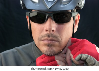 Close-up of bicycle courier putting on helmet.