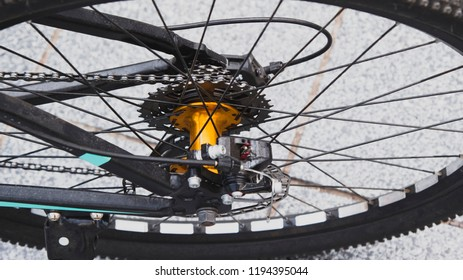 Closeup of a bicycle gears mechanism and chain on the rear wheel of mountain bike. Rear wheel cassette from a mountain bike. Close up detailed view.