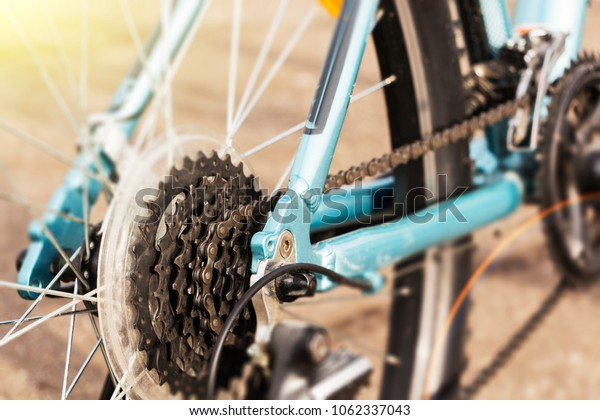 Closeup of a bicycle gears mechanism and chain on the rear wheel of mountain bike.