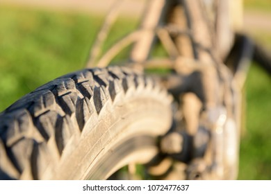 Close-up of bicycle tire with earth
