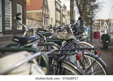 Close-up of bicycles parked in a Dutch street with old historic architecture