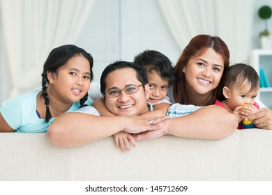 Close-up of a big family smiling and looking at camera