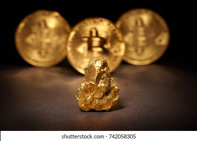Closeup of big gold nugget and Gold Bitcoins Coins on black background. Bitcoin cryptocurrency. Business concept.