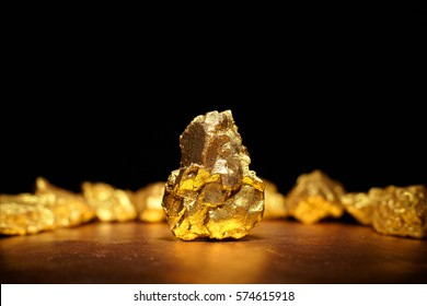 Closeup of big gold nugget finance concept