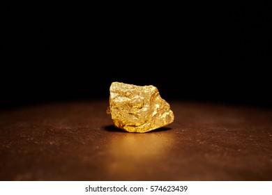 Closeup of big gold nugget finance concept