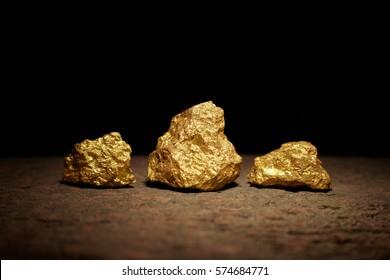 Closeup of big gold nuggets, business concept