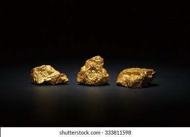 Closeup of big gold nuggets on black background