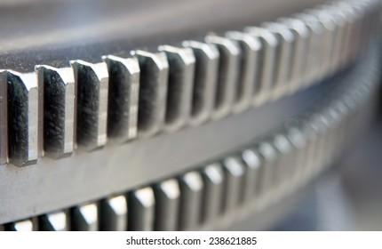 Closeup of big metal gear in a large european plant, blurred