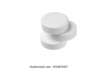 Close-up big round pills isolated on white background. Big white tablets of round shape on white background.
