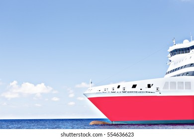 Closeup of a big ship on sea water, sunshine around the area, weather is good, white clouds are beautiful, luxury ships design.
