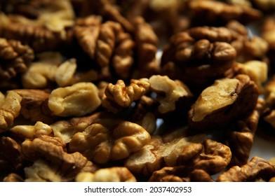 Closeup of big walnuts pile, shallow DOF.