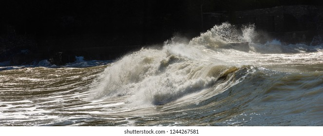 Close-up of big  waves breaking on the coast in Liguria, Italy, Europe