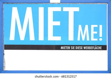 The close-up of a billboard and advertising space for rent for large-scale posters and advertising placards with the inscription Rent me / Advertising space for rent